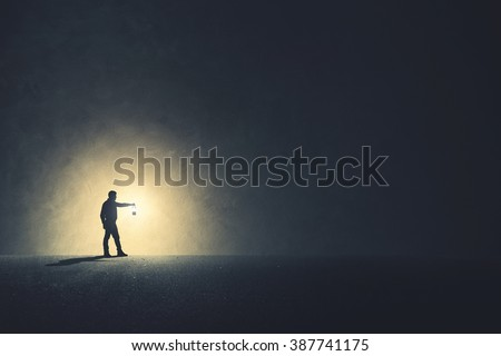 man with lamp walking...