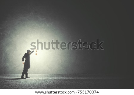 Man with lamp walking illuminating his path