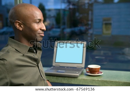 Man with laptop at coffee shop