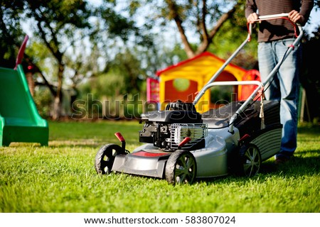 Man with lawn mower #583807024