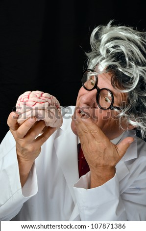 Man with long hair and brain/Crazy Genius Professor with Brain/Demonstration of the powerful brain