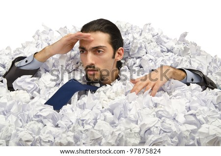 Man with lots of waste paper