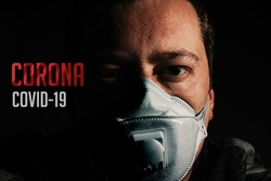 Man with mask for protection from corona virus covid-19 with text