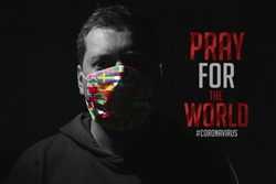 Man with mask for virus protection with text Pray for the World corona virus covid-19