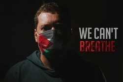 Man with mask with Palestinian flag with text we cant breathe