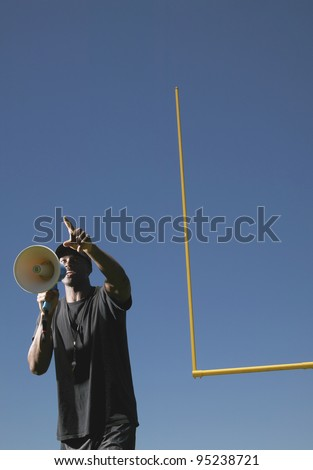 Man with megaphone on football field