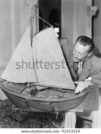 Man with model ship