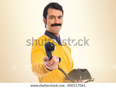 man with moustache  holding...