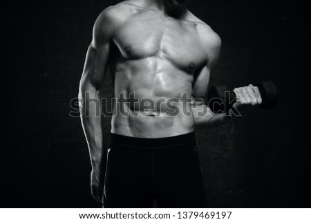 man with muscular muscular fitness workout dark background