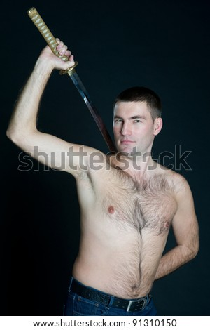 Man with naked torso with sword