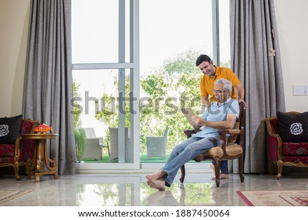 Man with old father using digital Tablet while planning budget finance