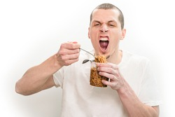Man with open mouth emotionally eating fast food noodles from the transparent plastic cup. Pasta. Eating. Meal. Hungry. Food. Instant. Happy. Nosh. Exited. Expression