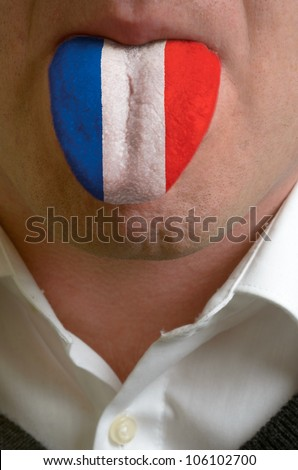 man with open mouth spreading tongue colored in france flag as symbol of values like teaching, learning, multilingual speaking different of languages