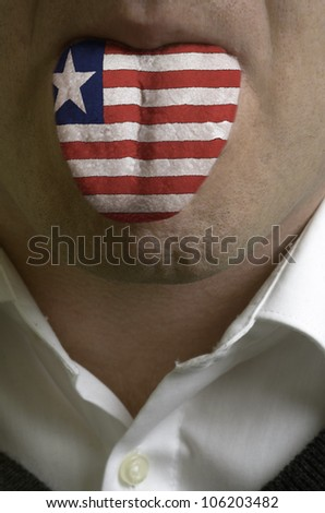 man with open mouth spreading tongue colored in liberia flag as symbol of values like teaching, learning, multilingual speaking of different languages