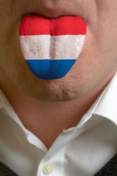 man with open mouth spreading tongue colored in netherlands flag as symbol of values like teaching, learning, multilingual speaking of different languages