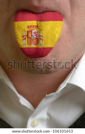 man with open mouth spreading tongue colored in spain flag as symbol of values like teaching, learning, multilingual speaking of different languages