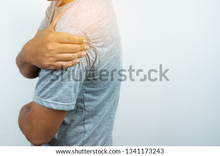 Photo of  Man with pain in shoulder and upper arm, Ache in human body , closeup