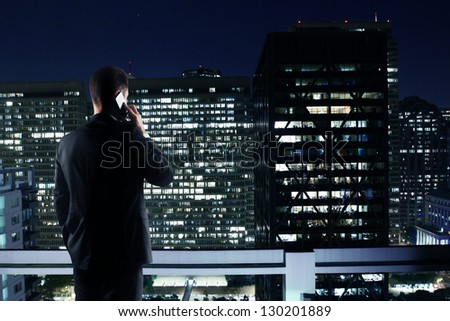 Man With Phone Looking To Night City