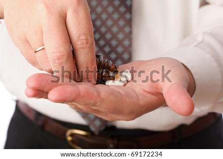 man with pill - blue white pills in man hand