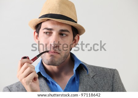 Man with pipe in mouth