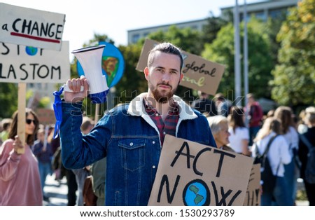 Man with placards and amplifier on global strike for climate change.