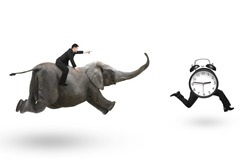 Man with pointing finger gesture riding elephant and running after alarm clock with human legs running, isolated on white background.
