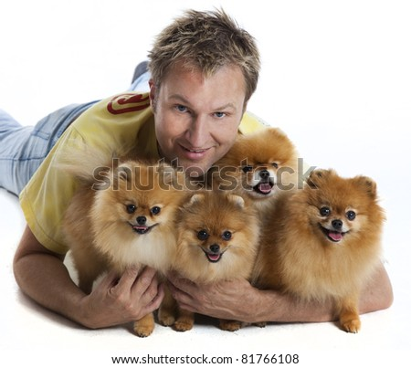Man with 4 pomeranian dogs