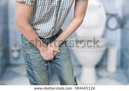 Man with prostate problem in front of toilet bowl. Incontinence