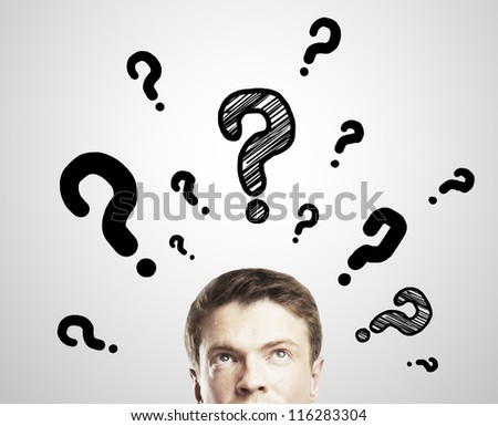 man with questions symbol on a white background