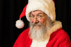 Man with real beard in Santa Claus dress