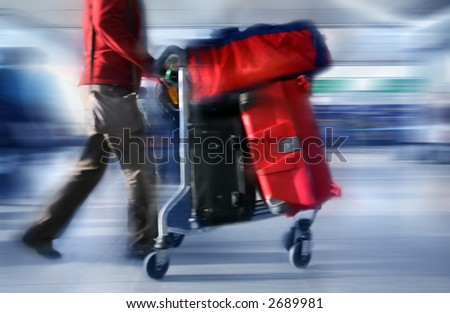 Man with red bags at the airport, motion blur