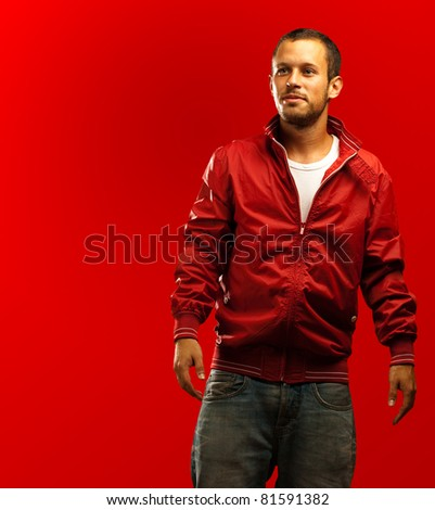 man with red jacket on a red background