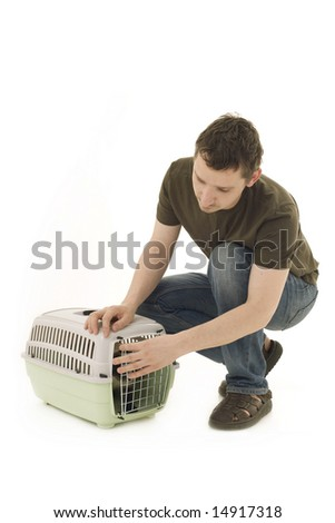 man with Siamese cat in pet carrier