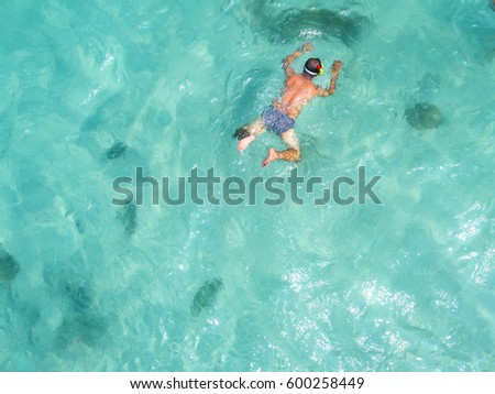 man with snorkle swimming in the sea in cleared water Stok fotoğraf ©