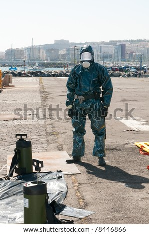 man with special ebola or virus dress or atomic contamination
