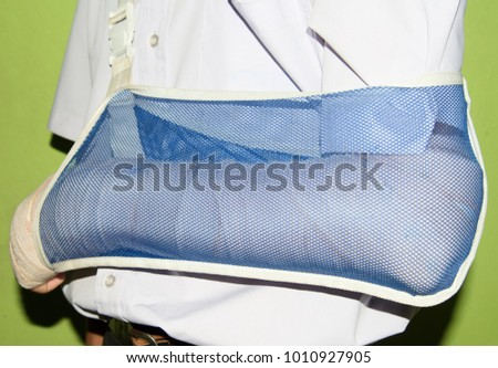 man with splint broken bone left wrist. #1010927905