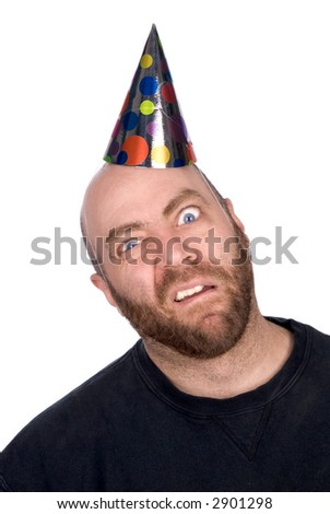 Man with strange expression wearing a party hat isolated over white