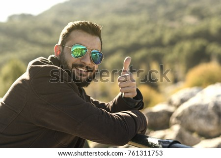 Man with sunglasses making ok symbol