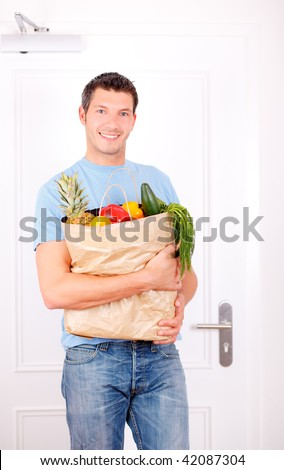 man with supermarket bag after buying healthy healthcare fruits