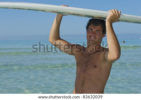 Man with surf board over his head