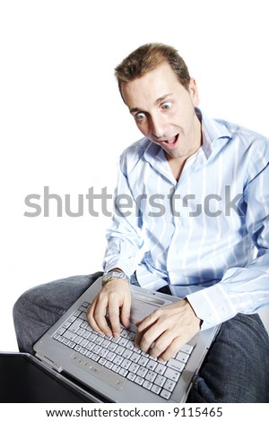Man with surprised face using a laptop computer. Isolation on white.