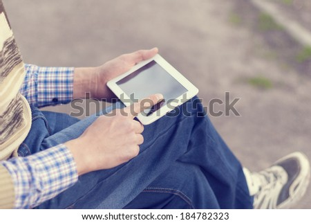 Man with tablet in hand on the street. #184782323