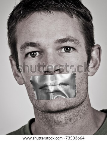 Man with tape over his lips