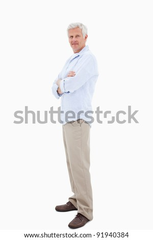 Man with the arms crossed against a white background