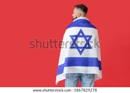 Man with the flag of Israel on color background, back view Stok fotoğraf ©