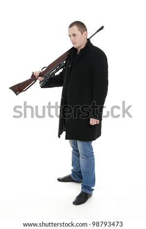 Man with the gun on the shoulder - stock photo