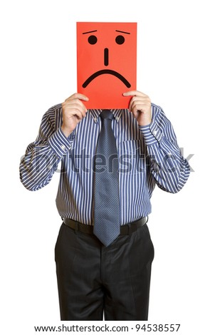 Man with the painted sad smile on the sheet of paper over his face isolated on white