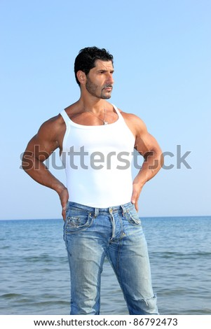man with tshirt posing at the beach