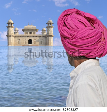 Man with turban near a palace in India.