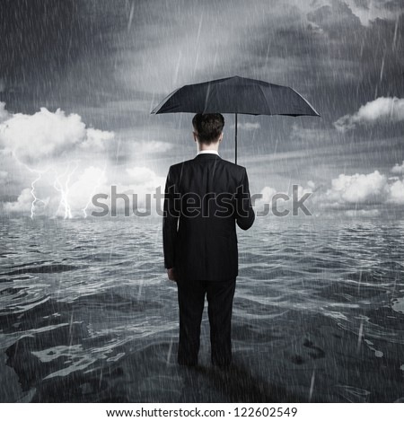 man with umbrella business concept